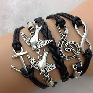 Jewelry - 3/$20 Black Multi Charm Bird Infinity Bracelet